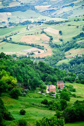 Lovely green lush countryside in the morning light. Italy