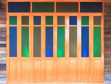 Closed door with colorful glass