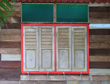 closed windows on rural wooden house