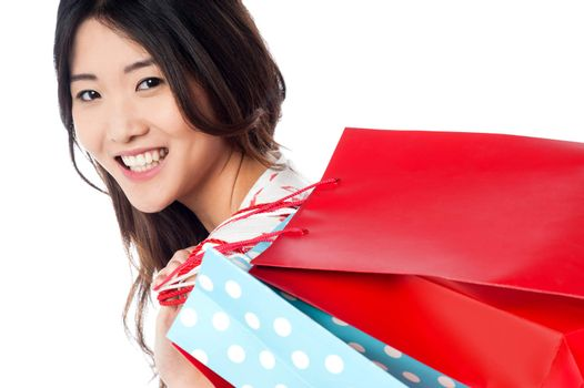 Cheerful young shopaholic girl