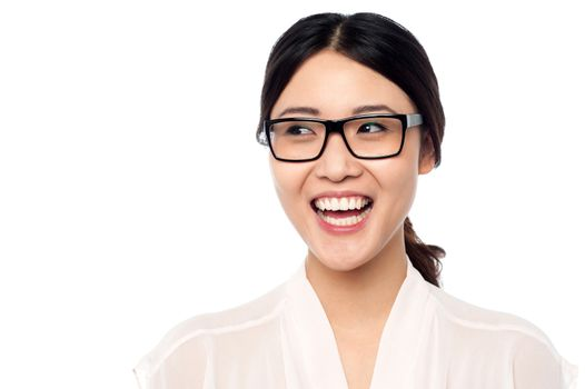 Cheerful young girl in eyeglasses