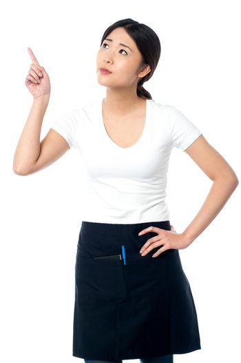 Asian waitress pointing and looking away