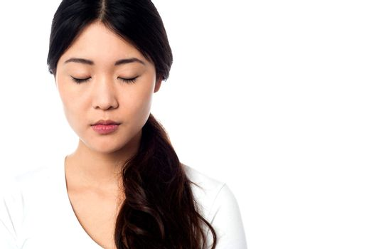Young girl with closed eyes at peace