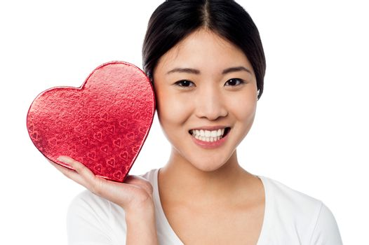 Woman displaying her valentine gift