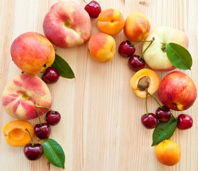 Wooden background with fresh fruits