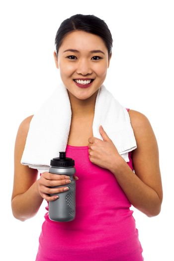 Athletic woman holding sipper bottle