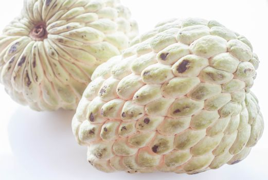 Couple unripe sugar apple isolated on white background