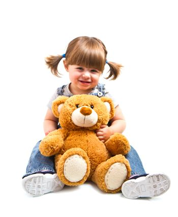 adorable toddler girl hugging a teddy bear