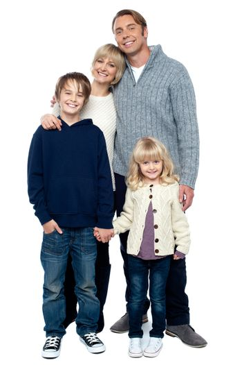 Affectionate family with children at studio