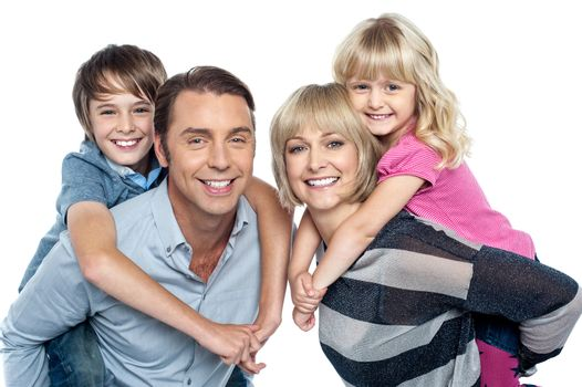 Caucasian family of four in the studio