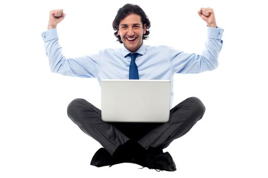 Excited young professional with laptop
