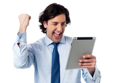 Excited businessman holding touch pad