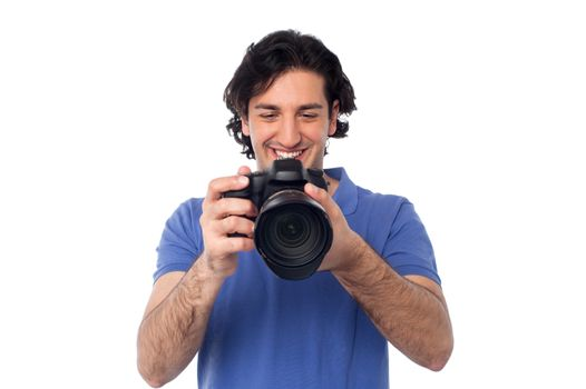 Man looking at pictures stored in camera