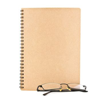 blank notebook and eyeglasses