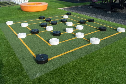 Colorful street outdoors draughts checkers board game in a playground