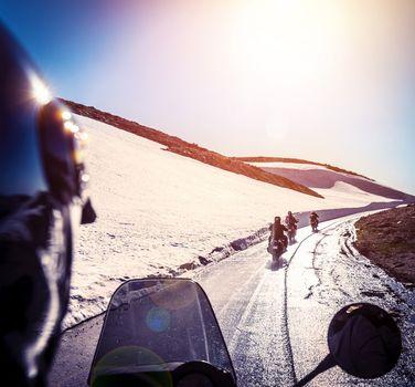 Group of bikers on snowy road