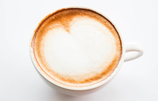 Cup of hot coffee latte with microfoam on top