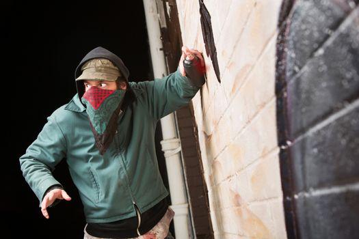 Worried Gang Member Spray Painting