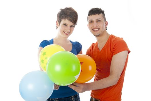 happy couple with colorful balloons on a white background