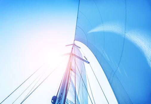 Sail on blue sky background