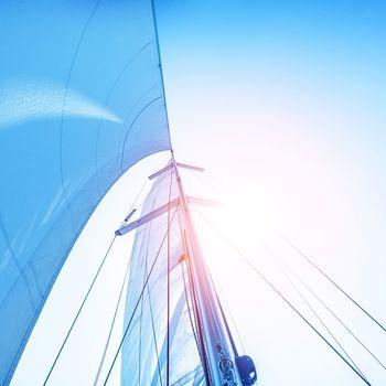 Sail on blue sky backdrop