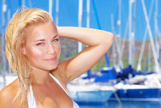 Beautiful woman in sailboat harbor