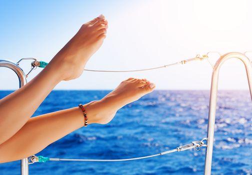 Women's feet on the yacht