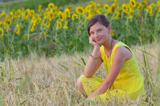 beautiful girl on fiel with background of sunflower