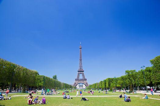 Eiffel Tower, Paris, France. Tourists and locals having a break on Champ de Mars