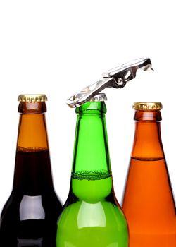 Threee bottles of beer and a opener