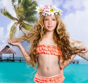 Beach tropical vacation kid blond girl with fashion flowers in head and palm tree vintage color