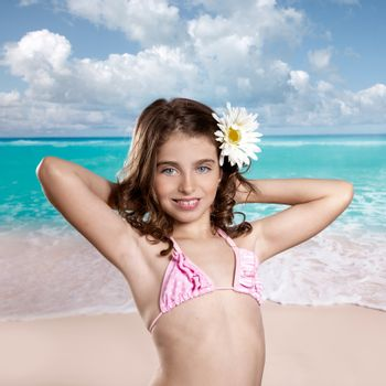 Brunette girl in tropical beach with daisy flower happy for vacation vintage color