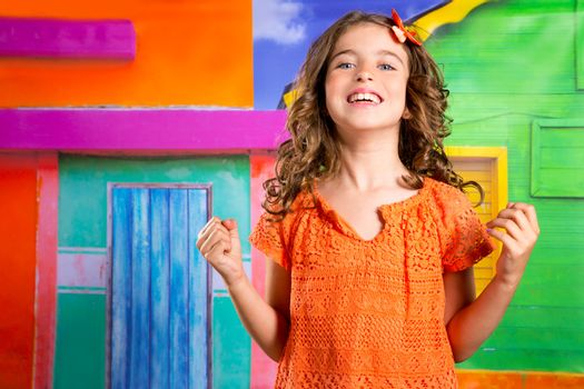 excited happy expression children girl gesture in a tropical colorful house vacation