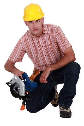 Woodworker with saw