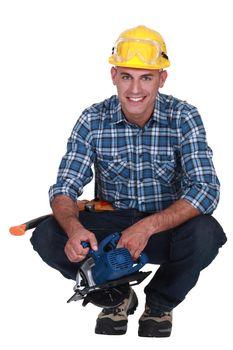 Smiling man with a circular saw