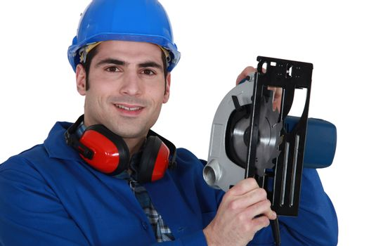 A manual worker with a circular saw.