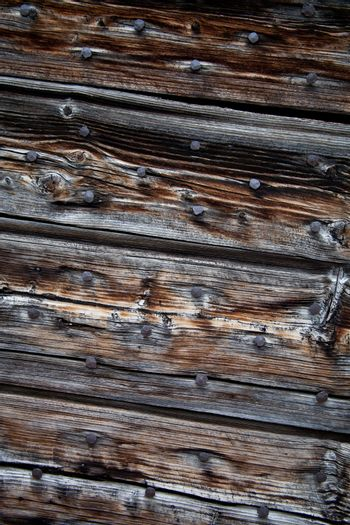 old, grunge wood panels with nails