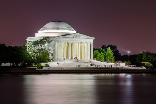 Scenic night view of the Jefferson Memorial in Washington DC reflecting in the Tidal Basin
