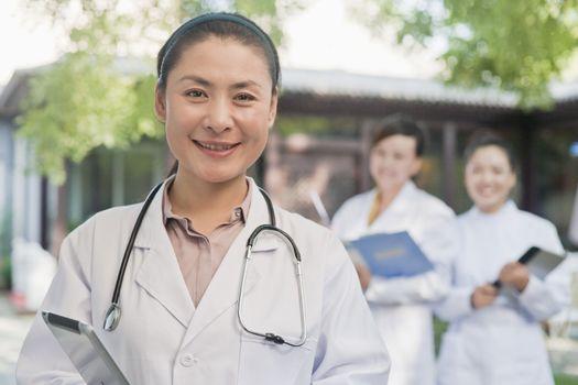 Portrait of Doctor in Courtyard