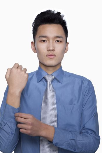 Businessman Buttoning His Sleeve