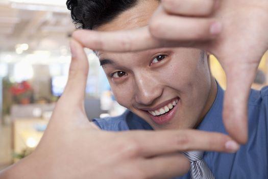 Businessman Framing His Face