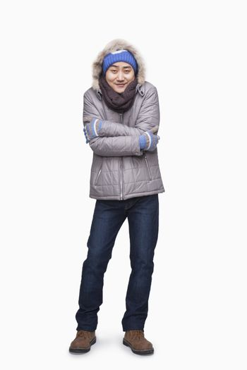 Man in winter clothes freezing