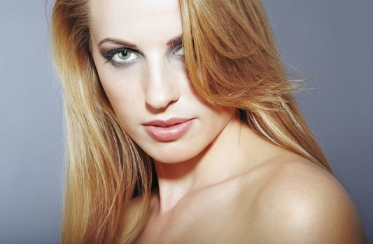Elegant lady with good skin and perfect makeup. Close-up horizontal portrait