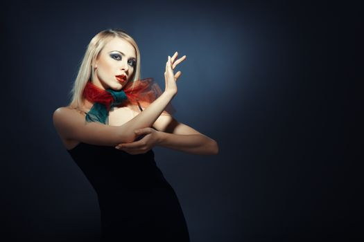 Elegant blond lady in stylish clothes on a dark background