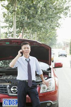 Businessman Calling for Roadside Assistance