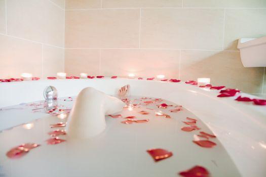 Young Woman Bathing at Health Spa