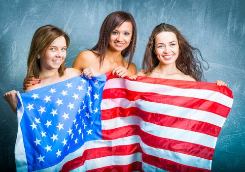 fashion girls with usa flag against textured wall