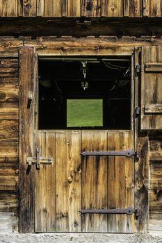 Wooden door of stable