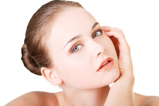 Beautiful face of spa woman with healthy clean skin. Isolated on white.