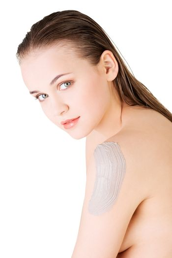 Beautiful face of spa woman with healthy clean skin and clay mask on arm. Isolated on white.